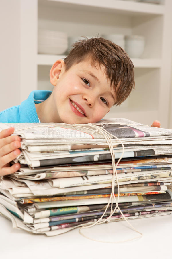 Young Boy Recyling Newspapers At Home royalty free stock photo