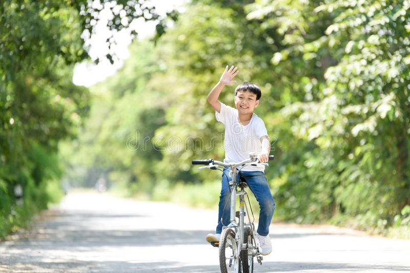 Young boy ride bicycle stock photo