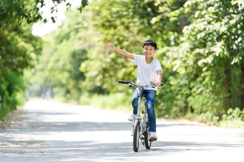 Young boy ride bicycle stock photos