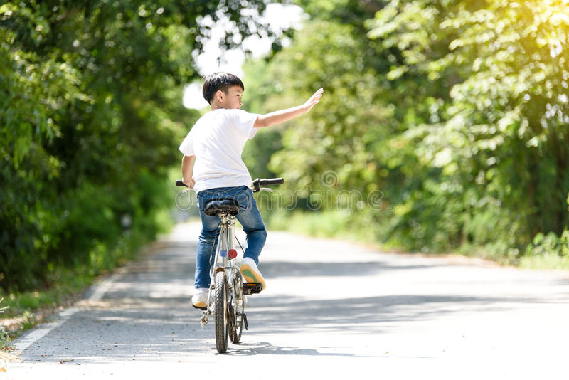 Young boy ride bicycle royalty free stock photography