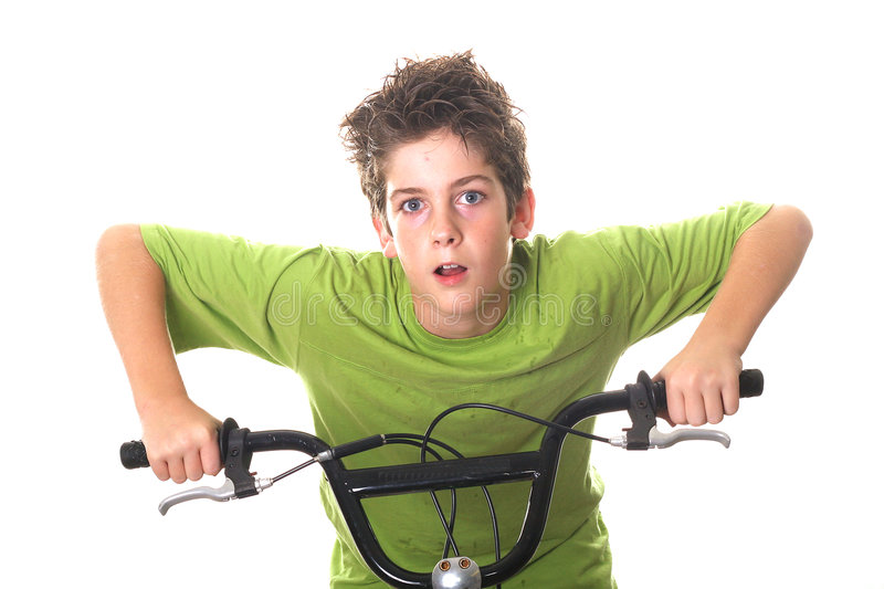 Young boy riding bicycle handle bars stock photography