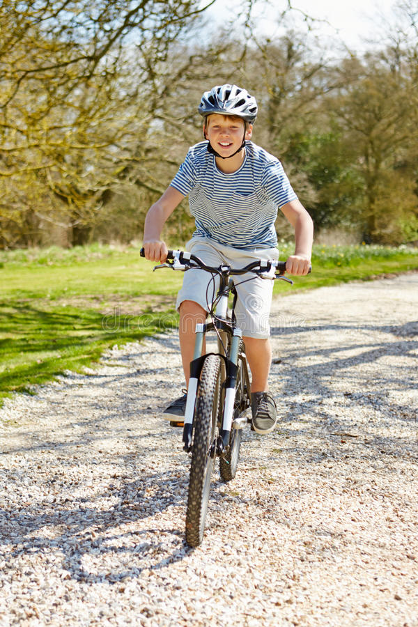 Young Boy Riding Bike Along Country Track royalty free stock photos