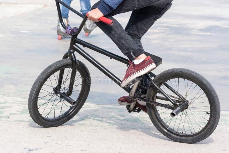 Download Young Boy Riding His BMX Bike Near Ramps Stock Photo - Image: 47595718