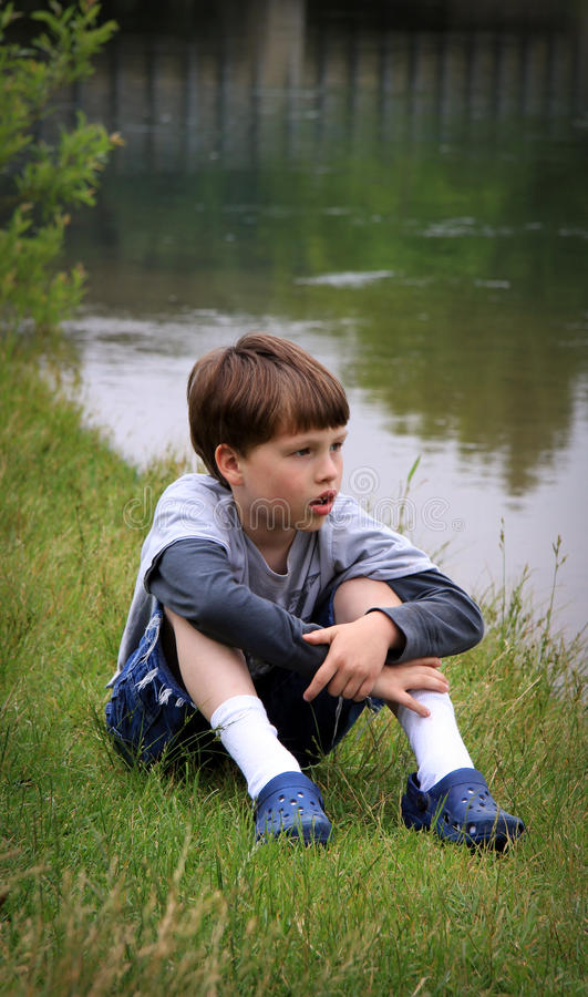 Young Boy at River stock image