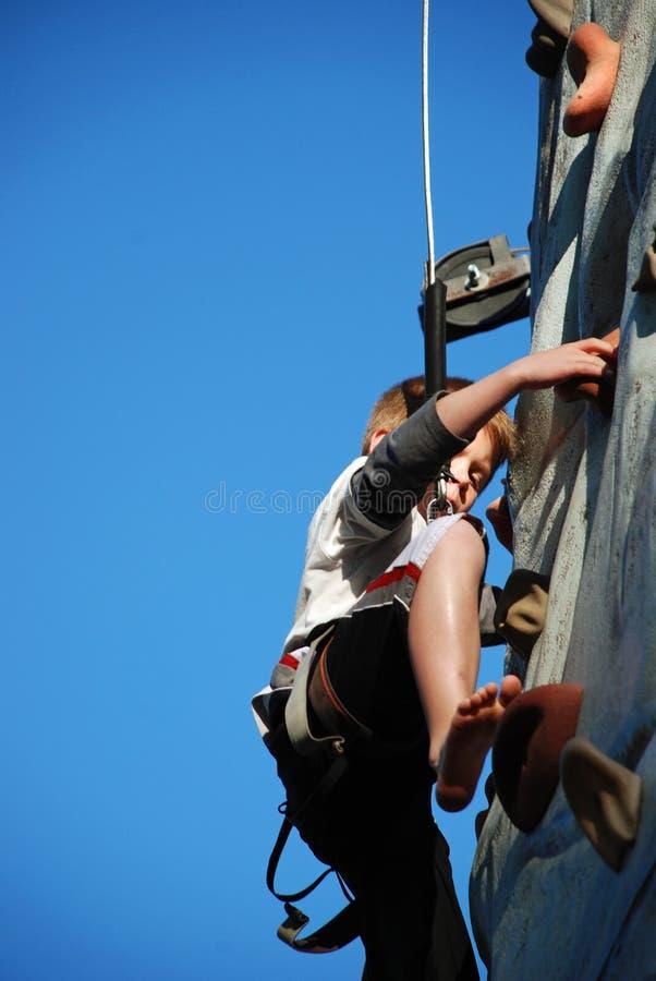 Young Boy Rock Climbing stock photo