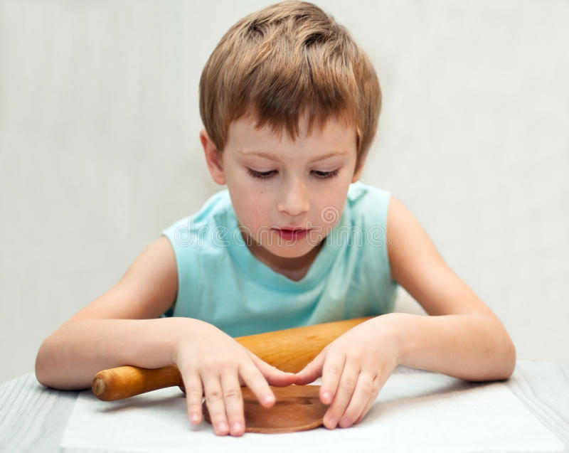 Young Boy Rolling Gingerbread Dough Stock Photo