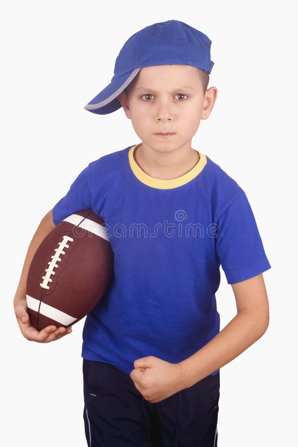 Young boy and rugby ball royalty free stock photo