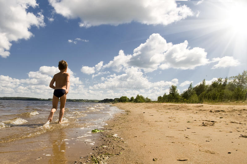 Young Boy Running At The Beautiful Beach Stock Image ... - photo#28