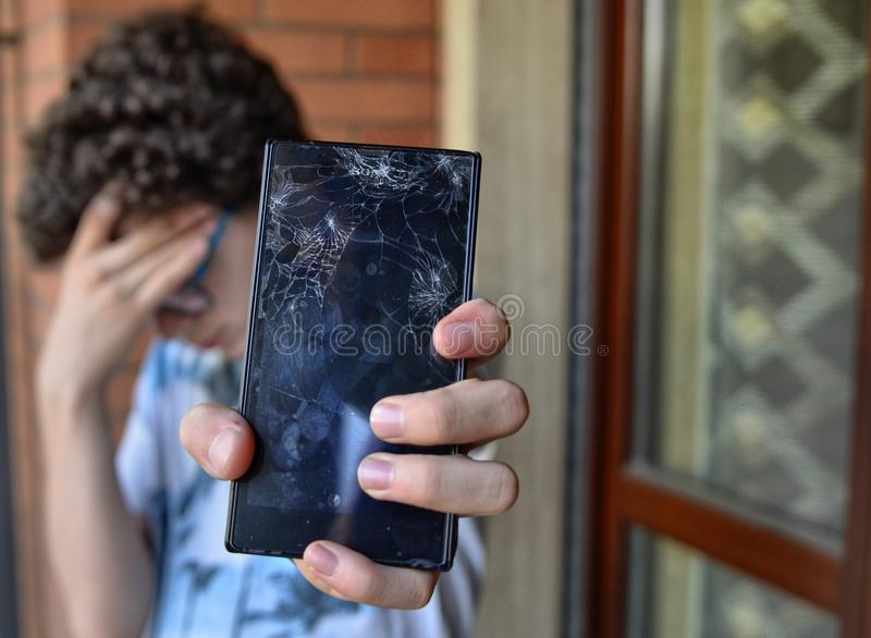 Young boy, sad and desperate for his smartphone royalty free stock image
