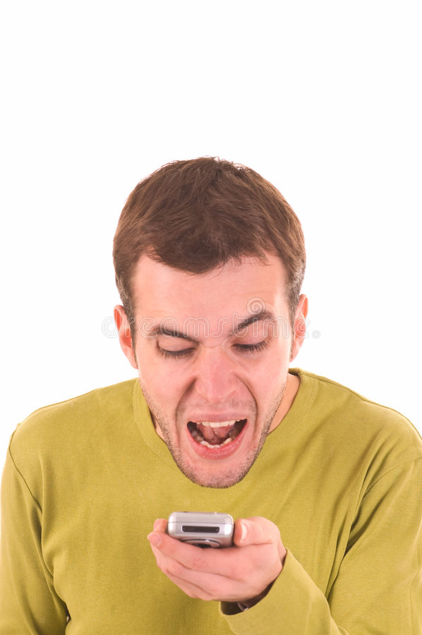 Young boy screaming on the mobile phone.