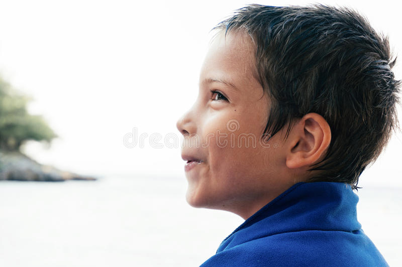 Young boy at seaside stock images