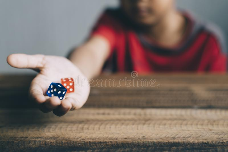 Young boy showing dice royalty free stock photos