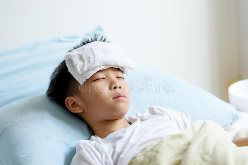 Young boy sick and sleep on the bed stock photo