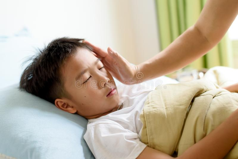 Young boy sick and sleep on the bed royalty free stock images