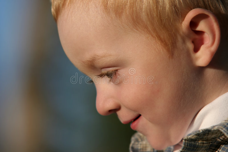 Young boy side portrait stock photos