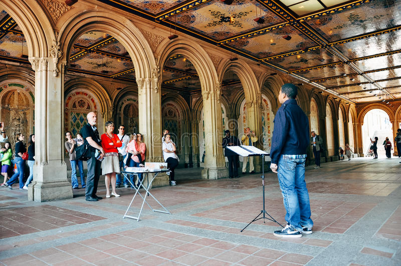 Young boy sings in Central Park. stock photography