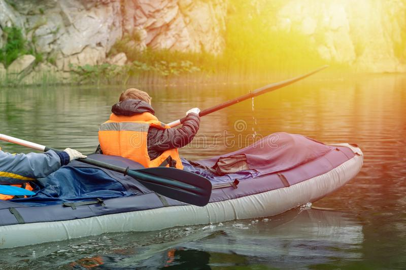 A young boy sits at the very front of the raft. royalty free stock photo