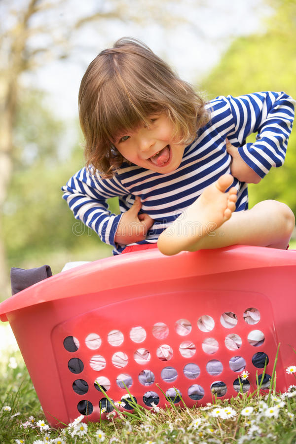 Download Young Boy Sitting In Laundry Basket Stock Photo - Image: 26103682