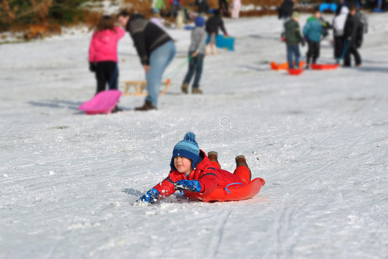 Download Young Boy Sliding Snowy Hill, Winter Fun Stock Image - Image: 23226685
