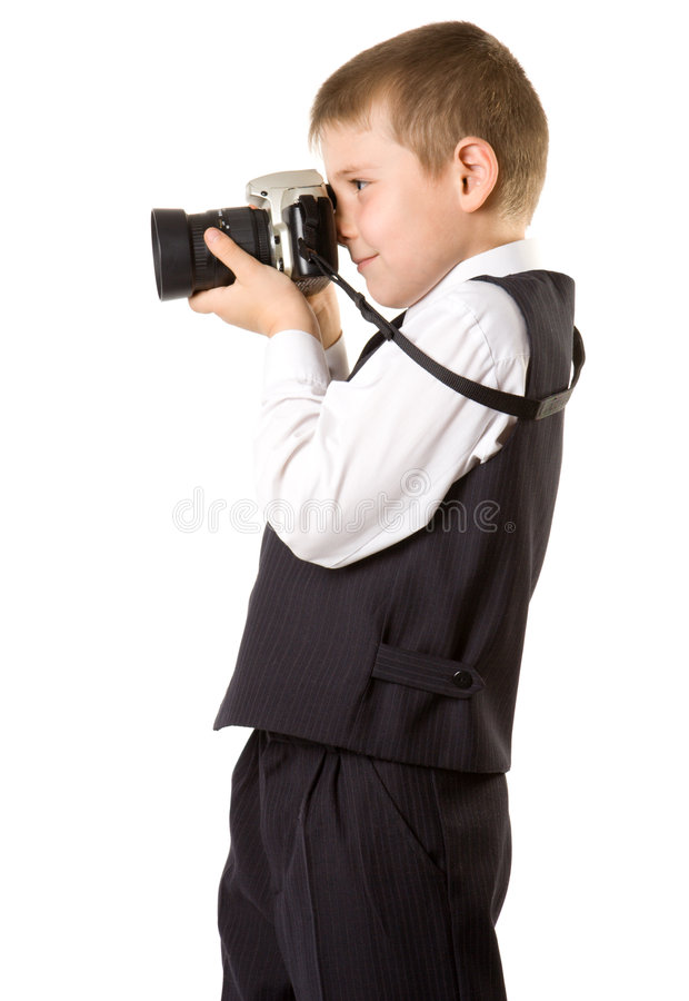 Young boy with SLR camera. Isolated oin white royalty free stock images