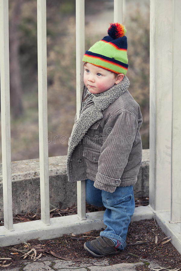 Young Boy. Small boy all rugged up for winter with beany and warm jacket royalty free stock image