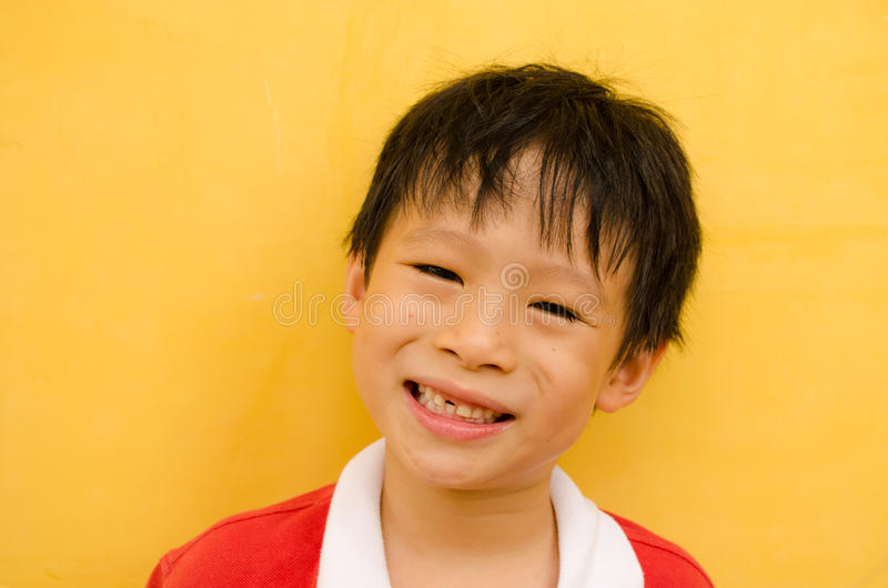 Young boy smiles missing teeth royalty free stock photos