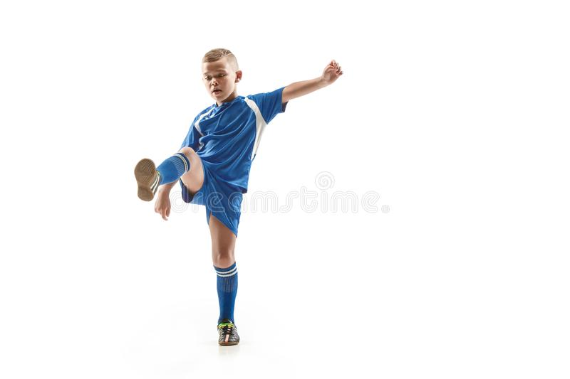 Young boy with soccer ball doing flying kick stock photography