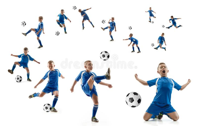 Young boy with soccer ball doing flying kick royalty free stock photography
