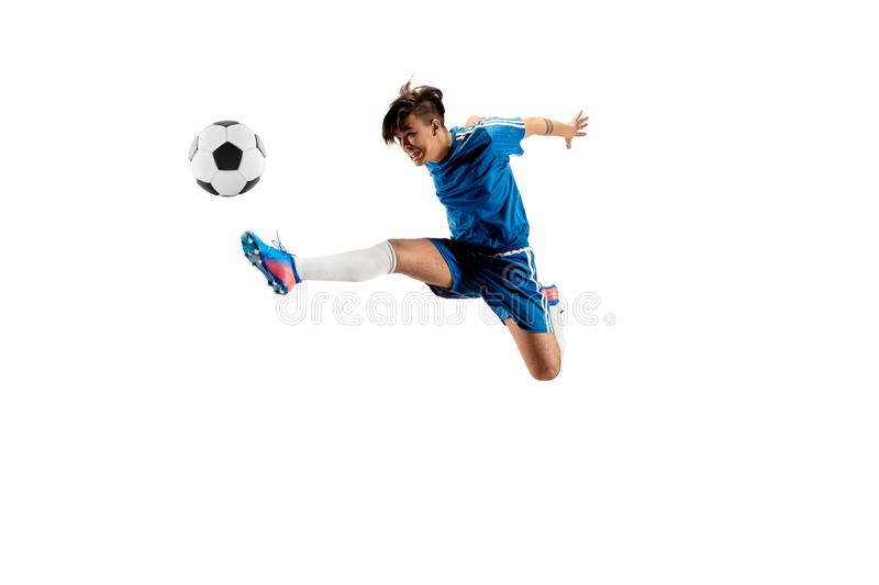 Young boy with soccer ball doing flying kick stock images