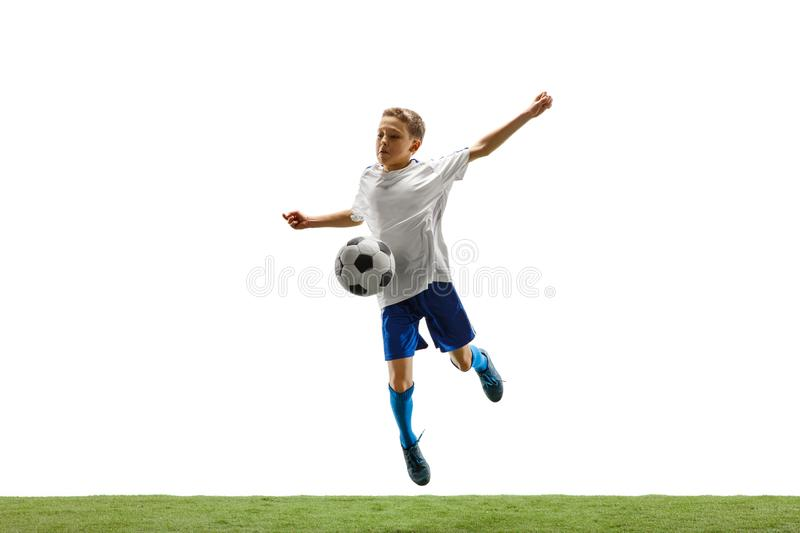 Young boy with soccer ball isolated on white. football player. Young boy with soccer ball running and jumping isolated on white studio background. Junior stock photo