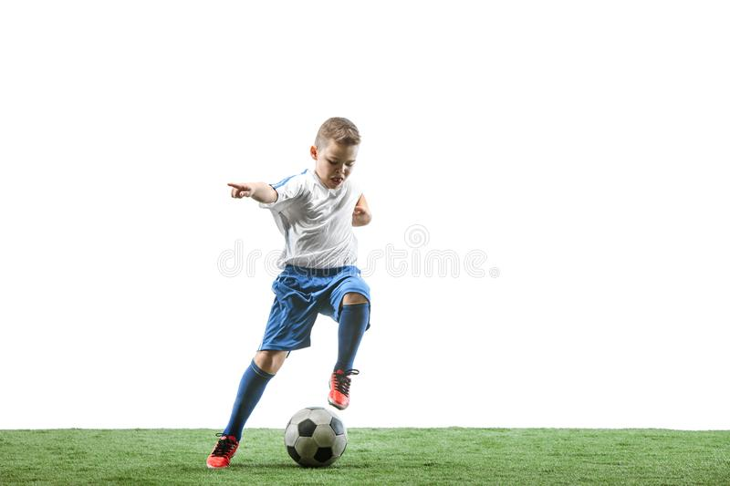 Young boy with soccer ball isolated on white. football player. Young boy with soccer ball running and jumping isolated on white studio background. Junior royalty free stock images