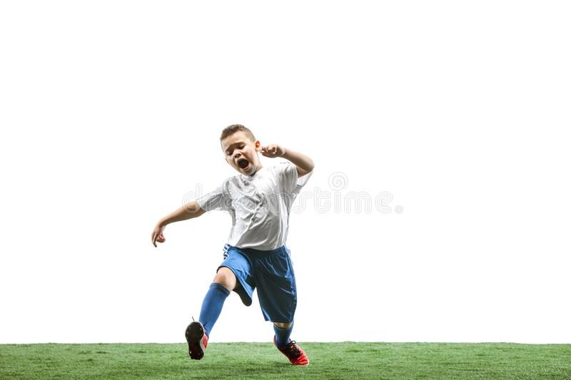 Young boy with soccer ball isolated on white. football player. Young boy with soccer ball running and jumping isolated on white studio background. Junior stock images