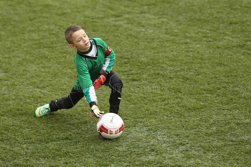Young boy soccer goalkeeper stock photography