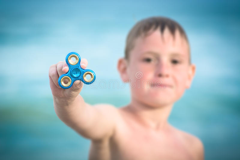 Young boy and spinner stock images