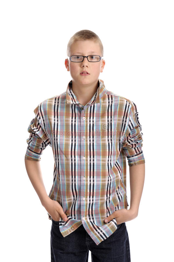 Young boy , standing hands in his pockets