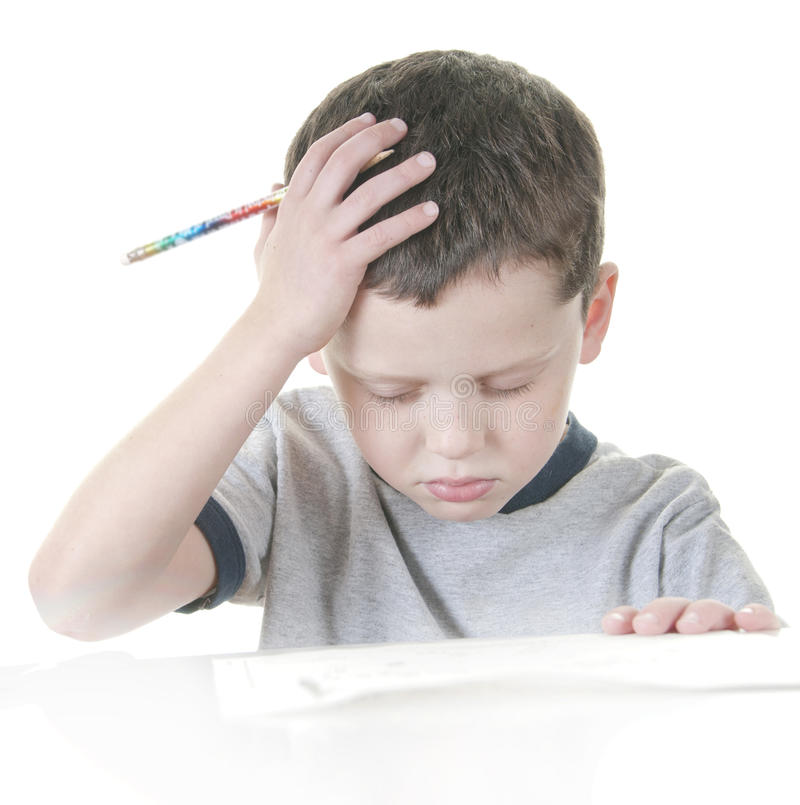Young boy stressed with work stock photos