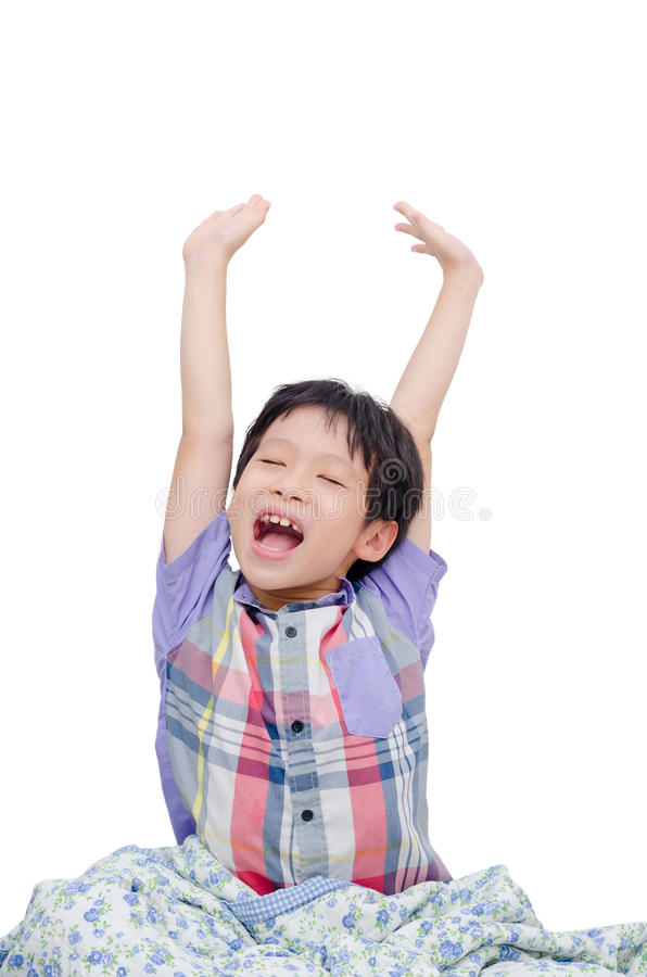 Young boy stretching over white stock photo