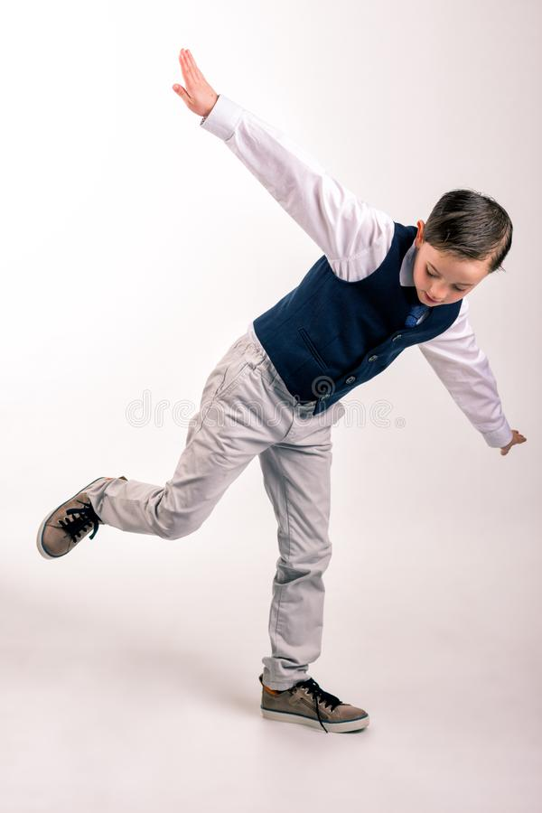 Young boy in suit spreading hands stock images