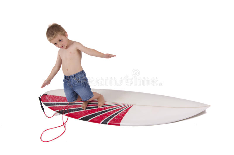 Young boy surfing stock image