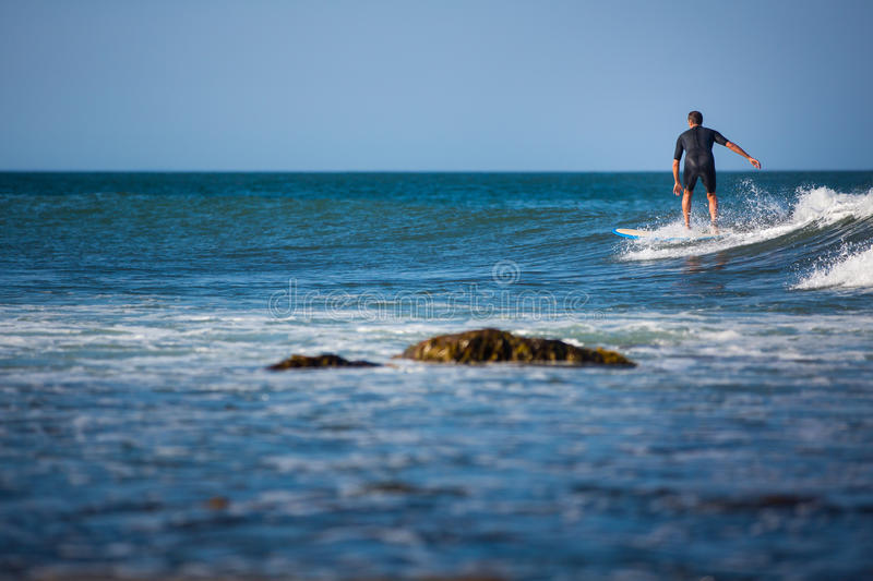 Young boy surfing the wave royalty free stock images