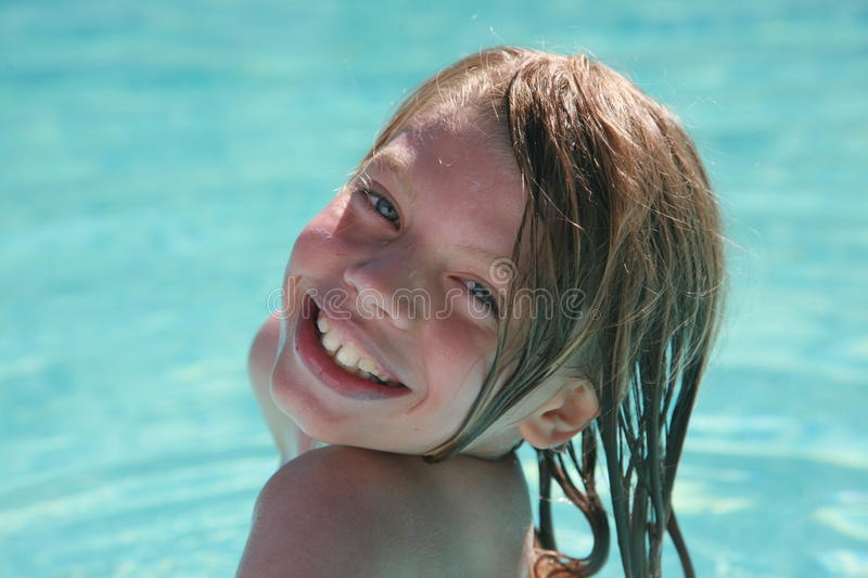 Download Young boy at swimming pool stock image. Image of tooth - 11404383