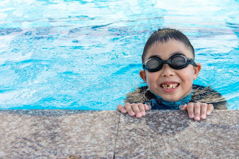 Young boy swimming in pool.  stock photography