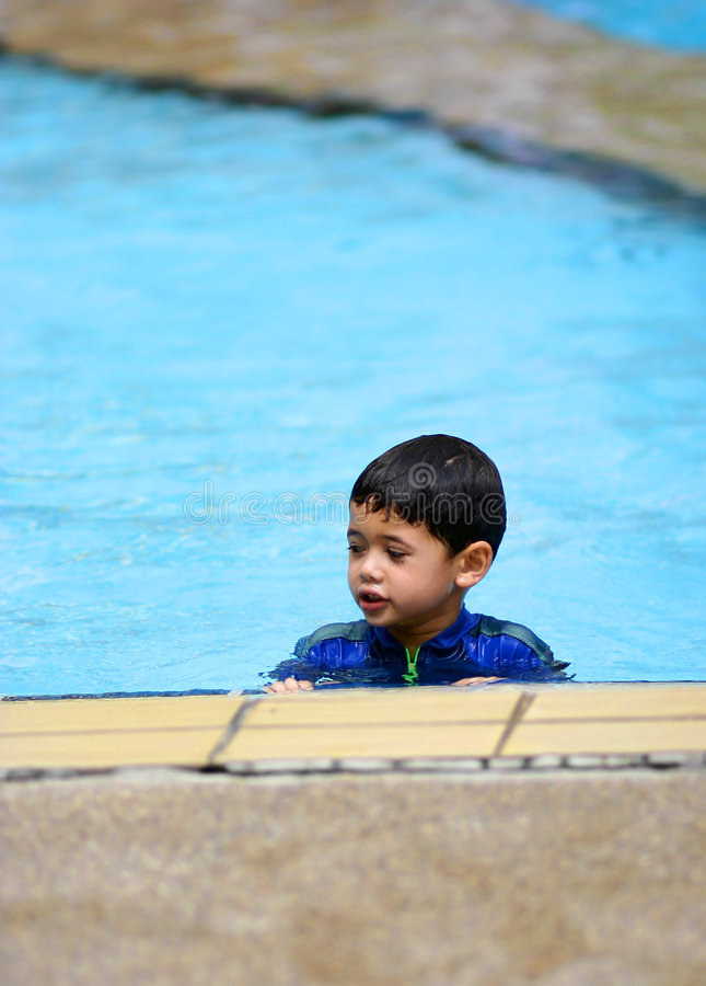 Download A Young Boy In  A Swimming Pool Stock Photo - Image: 1974124