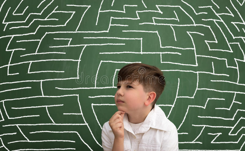 Young boy thinking stock images