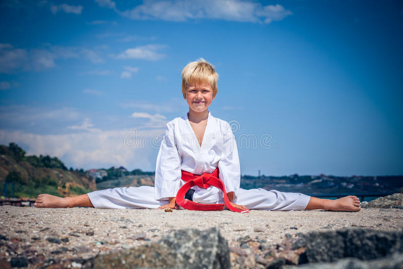 Young boy training karate stock images