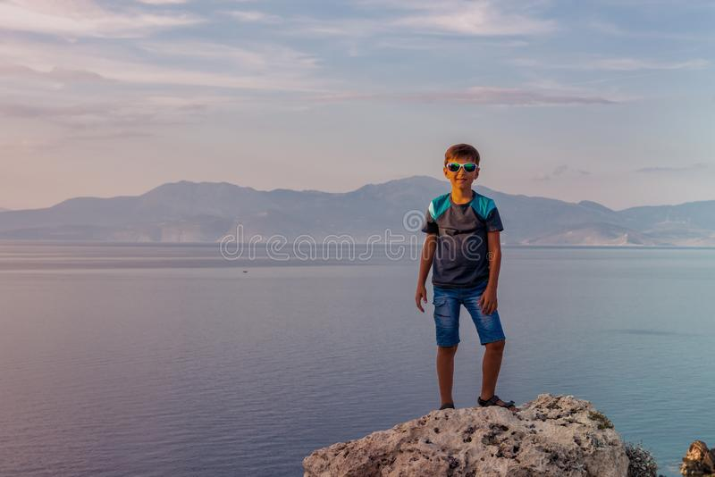 Young boy traveling along the coast of the Mediterranean Sea royalty free stock image