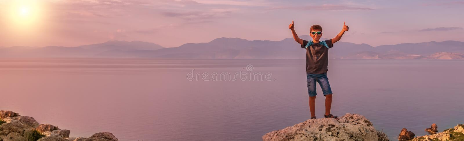 Young boy traveling along the coast of the Mediterranean Sea stock photo
