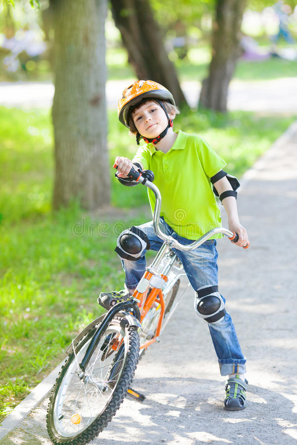 Young boy trying to ride bicycle royalty free stock photo