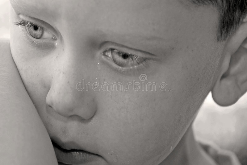 Young boy upset stock photography