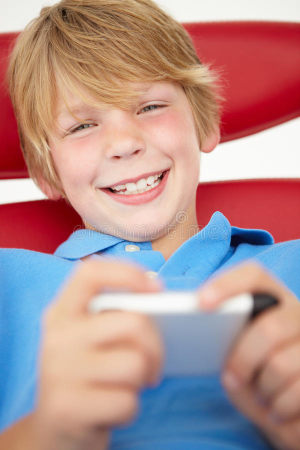Download Young boy using cellphone stock photo. Image of happy - 20788580
